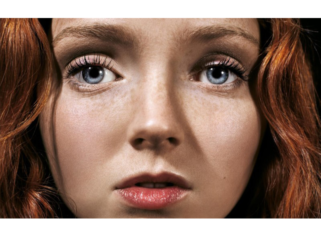Model Lily Cole up close with red hair