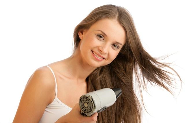 Girl blow drying hair