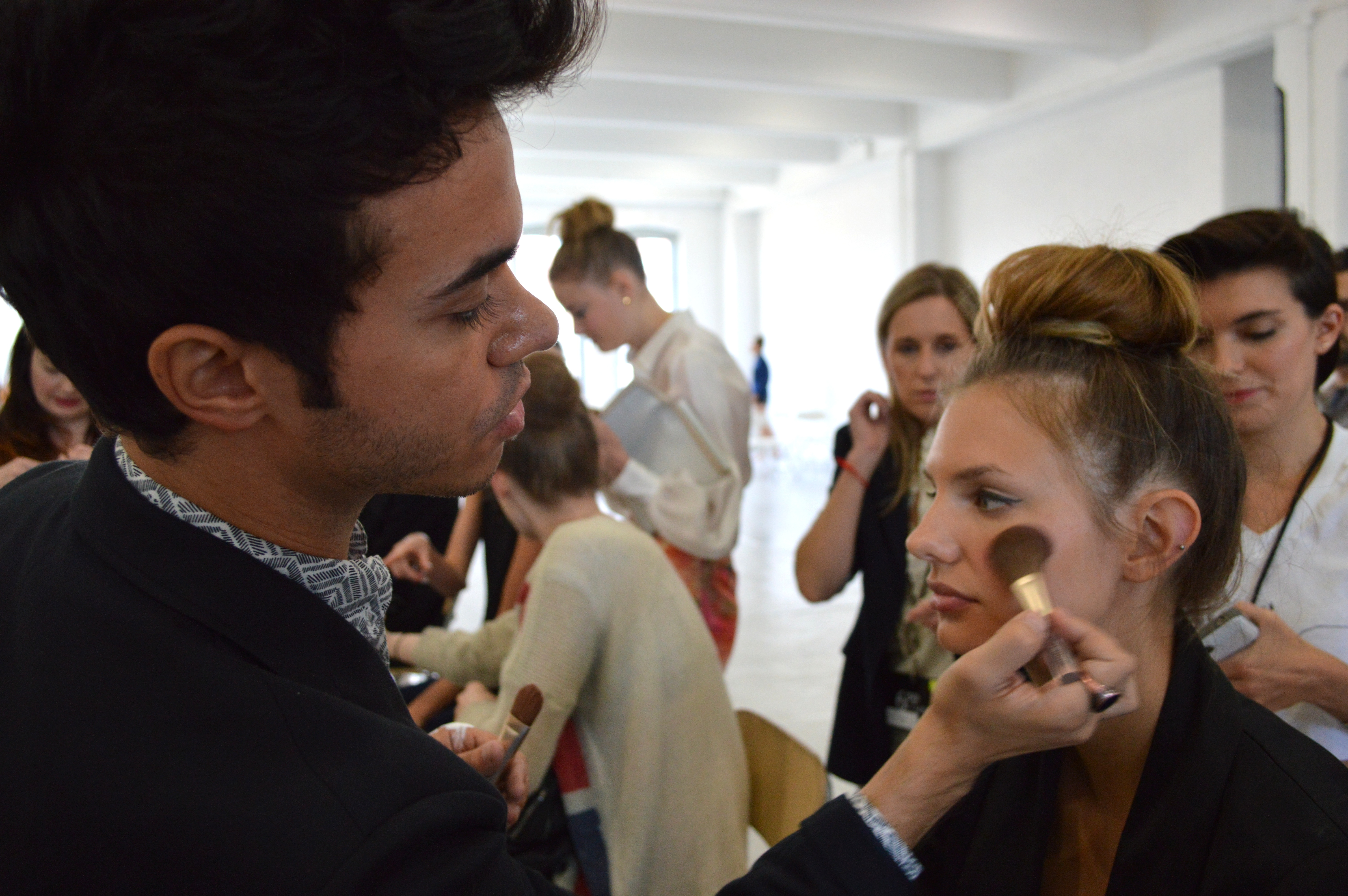 Lead makeup artist Neil Scibelli working his magic for Jouer Cosmetics backstage at Kate Spade New York.