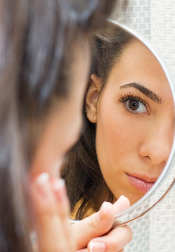Woman examining her pores
