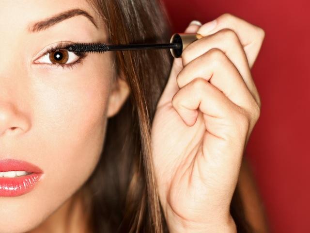 Girl putting on mascara