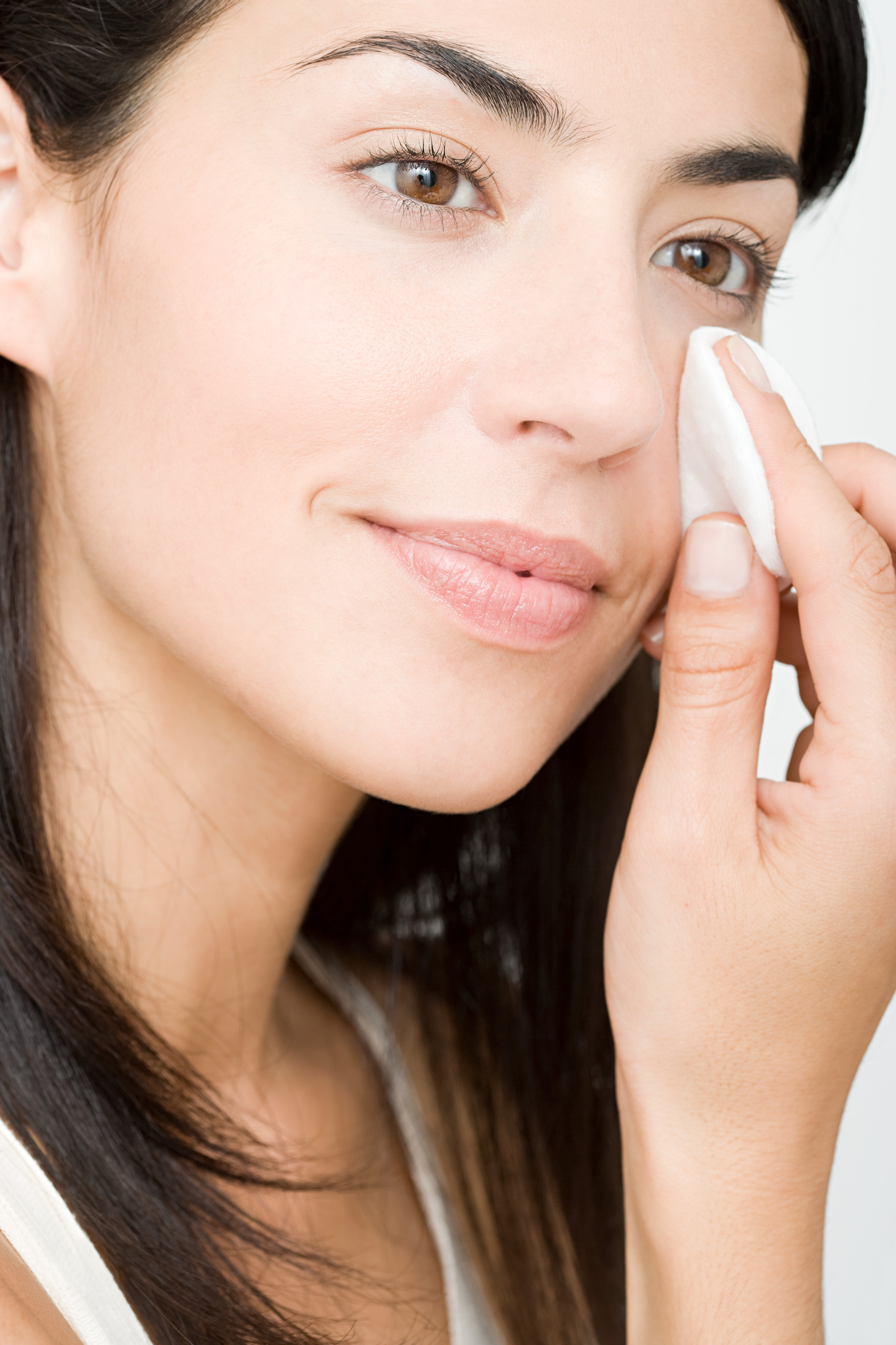 woman using makeup remover wipe