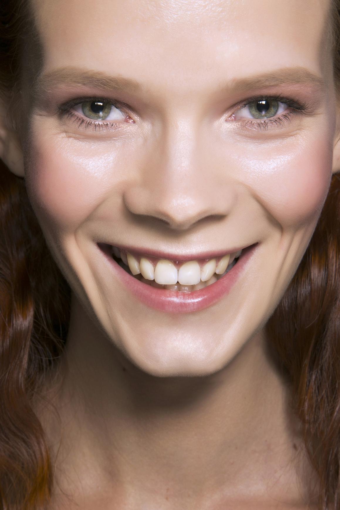girl smiling wearing no makeup