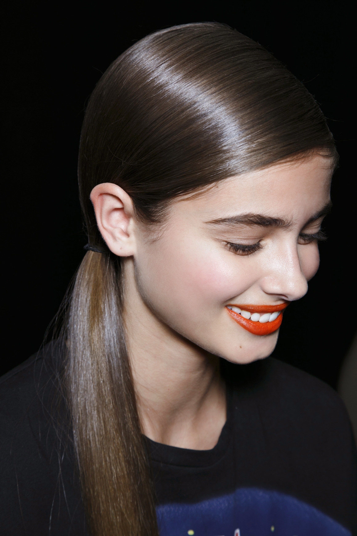 Girl with a sleek ponytail and matte lip