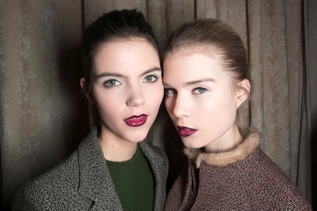 Girls wearing burgundy lipstick