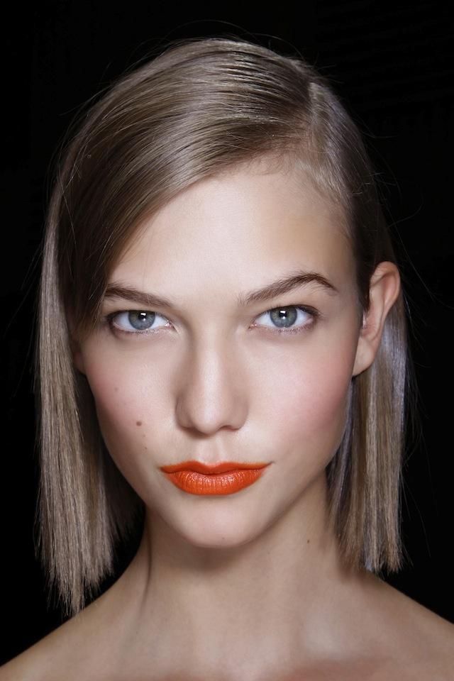 Model with orange lipstick