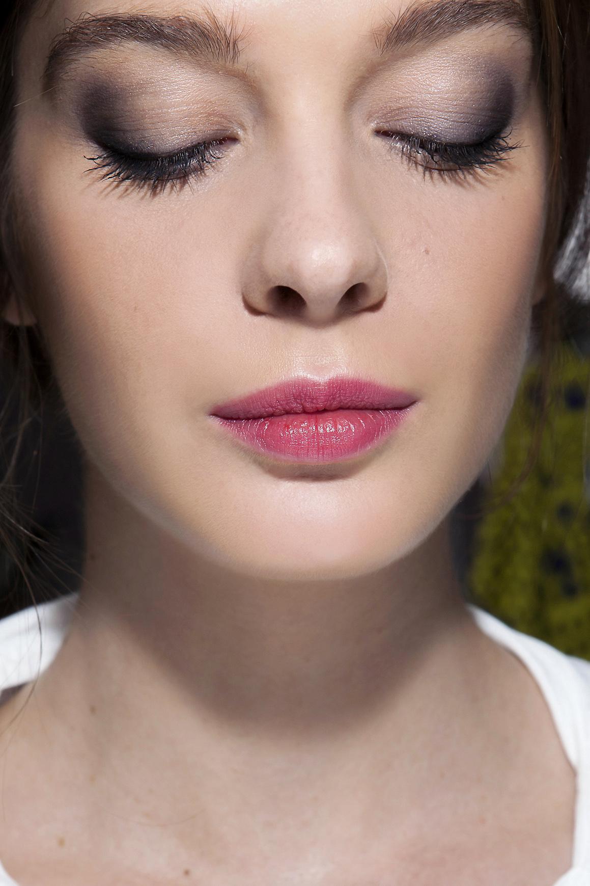 girl wearing pink lipstick and smokey eye makeup