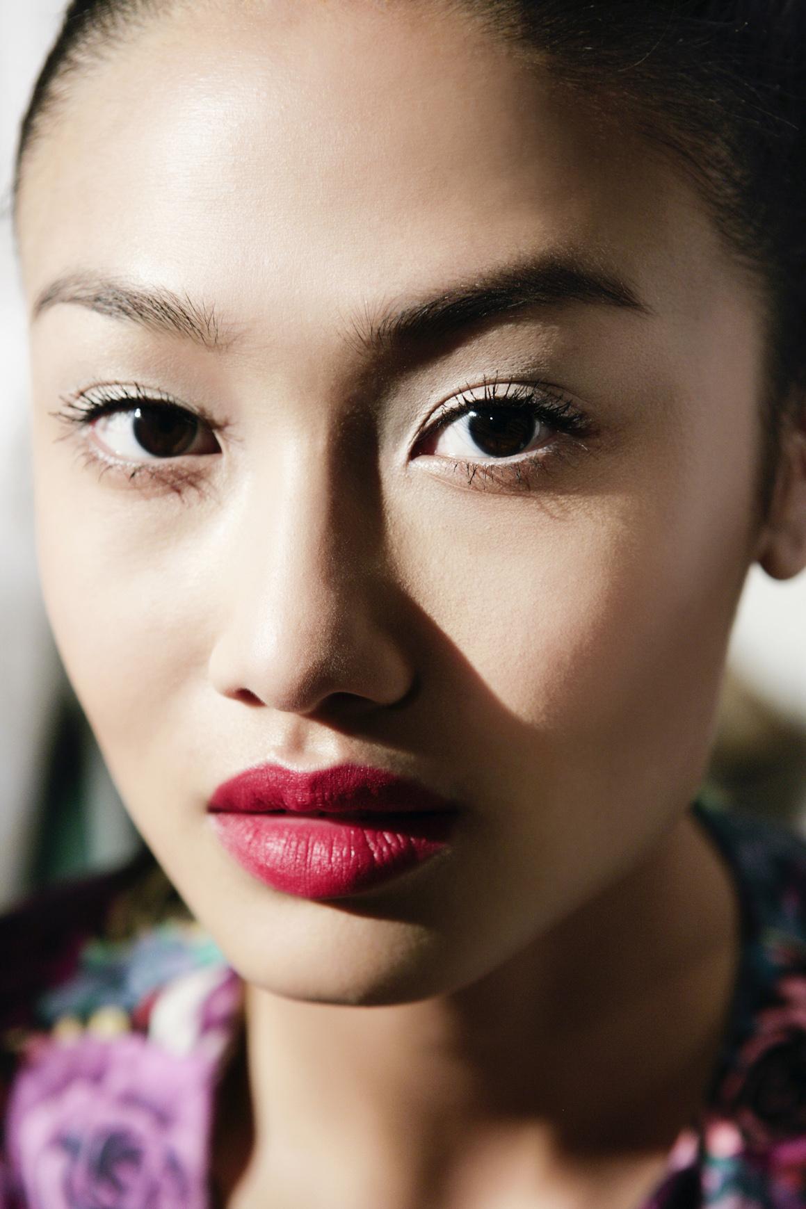 girl wearing hot pink lipstick