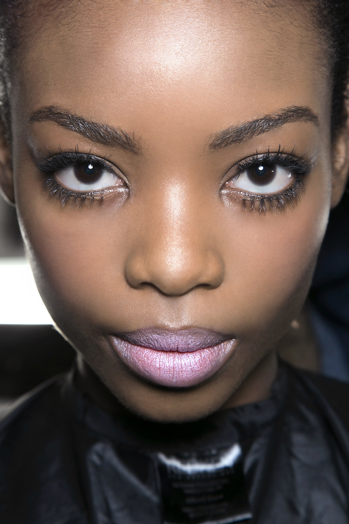 girl wearing pink lipstick and mascara