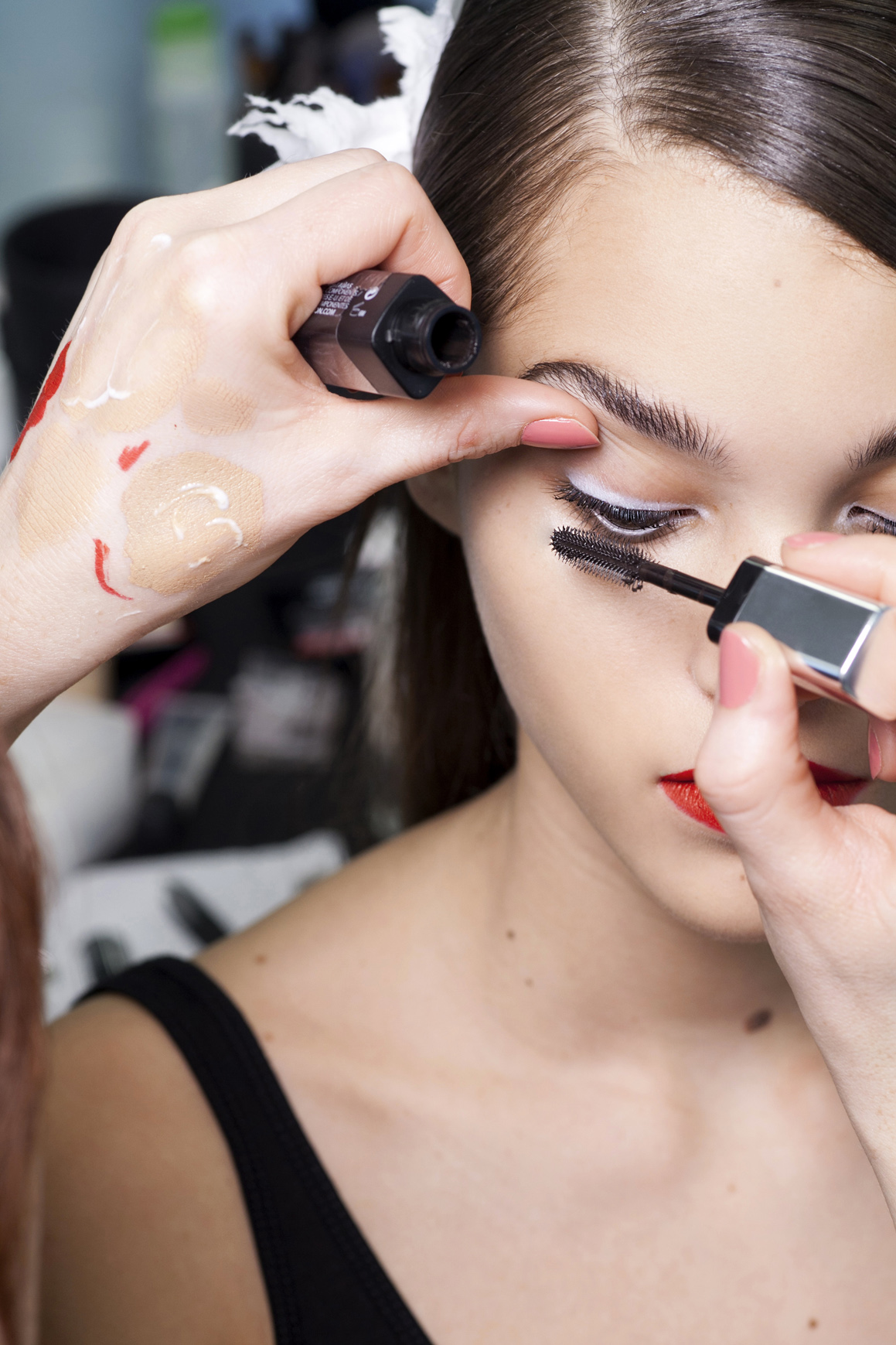girl applying makeup