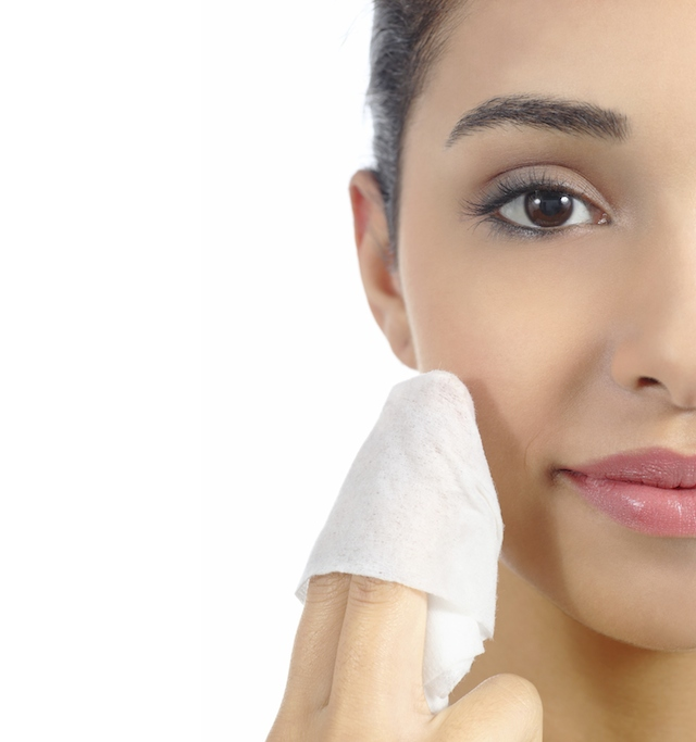 Woman removing make up with facial wipe