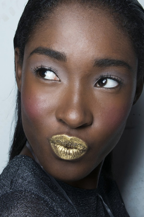 Model with gold lipstick