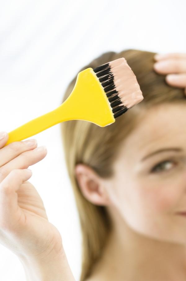 woman dyeing hair