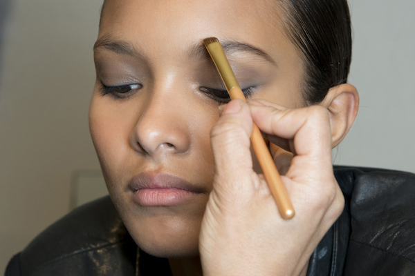 Girl getting her makeup done